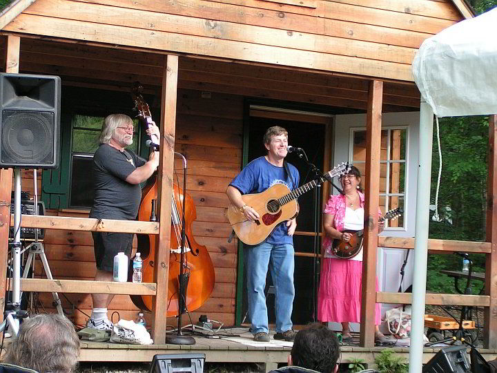 band performing on the cabin porch